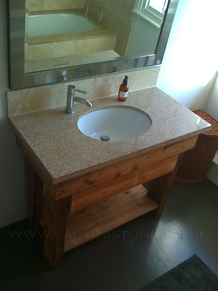 Granite worktop with under counter basin. Vanity unit made from reconstituted purlins and pine floorboards